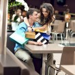 Young happy couple at the shopping center — Stockfoto