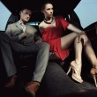 Beautiful couple sitting in a limousine — Foto de Stock