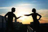 Young couple over evening city background — Stock Photo