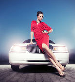 Sexy lady in front of a limousine — Stock Photo
