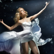 Stock Photo: Blonde beauty posing over starry background