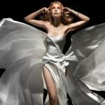 Gorgeous female model wearing white dress — Stock Photo