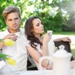 Young couple enjoying lunch in the garden — Stock Photo #5827668