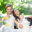Young couple enjoying lunch in the garden — Stock Photo
