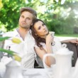 Stock Photo: Young couple enjoying coffee in the garden