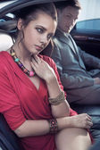 Handsome elegant couple traveling a luxury vehicle — Stock Photo
