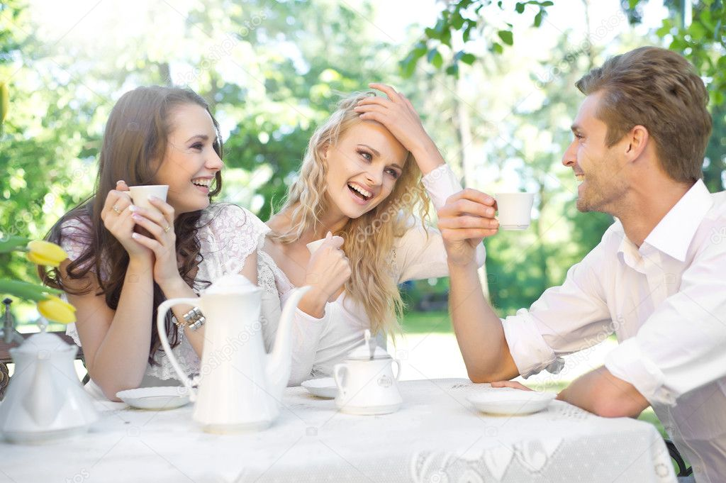 Friends having good time in summer garden  Stock Photo #5827651