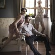 Foto Stock: Young male and female models posing in a stylish interior