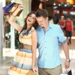 Cheerful couple in a shopping center — Stock Photo #6018939