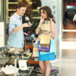 Young couple in a shopping center — Stock Photo