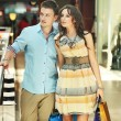 Royalty-Free Stock Photo: Young couple with shopping bags