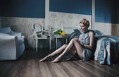 Red haired woman in stylish room — Stock Photo
