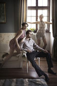Young male and female models posing in a stylish interior — Stock Photo