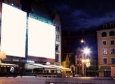 Empty white board over city night background — Stock Photo