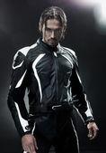 英俊的男人戴着摩托车制服 — 图库照片
