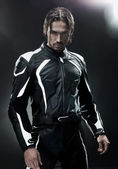 Handsome man wearing motorbike uniform — Stock Photo