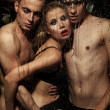Sexy woman posing with men — Stok fotoğraf