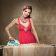 Pretty young lady ironing — Stock Photo