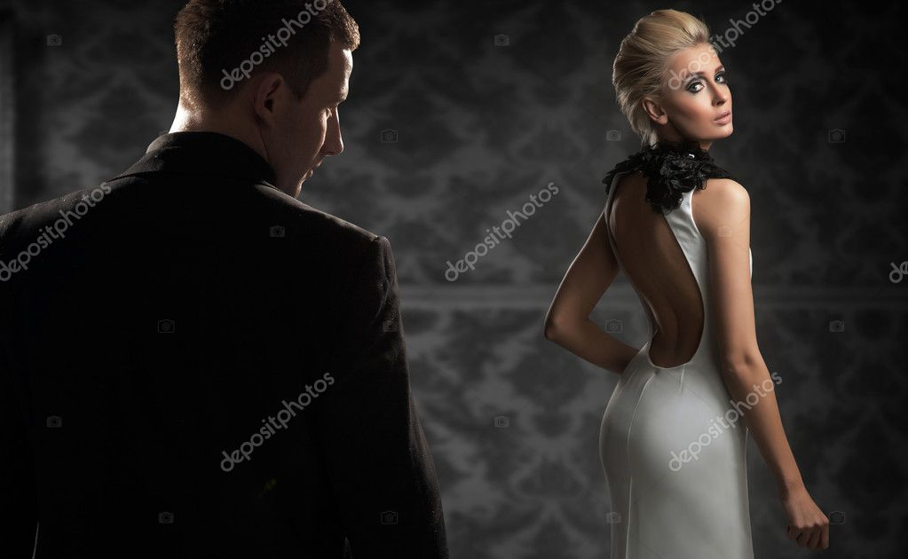 Handsome couple in a dark room — Stock Photo #6277945