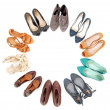 Many pairs of shoes in circle - Stok fotoğraf