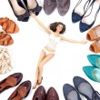 Beauty woman in lingerie among many pairs of shoes — Stock Photo #6578961