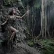 Sexy woman as a part of tree — Stock fotografie