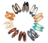 Many pairs of shoes in circle — Stock Photo