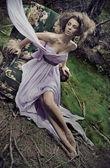 Glamorous woman wearing beautiful dress — Stock Photo