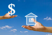 Small hand exchange the house with money from big hand — Stock Photo