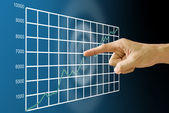 Finger push the stock exchange's statistic graph — Stock Photo