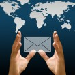 Stock Photo: Hand carry email icon with world map background, Concept