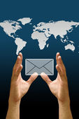 Hand carry the email icon with the world map background, Concept — Stock Photo