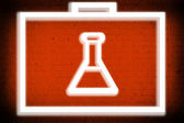 Chemistry for healing symbol on red paper background — Stockfoto