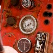 Old oil meter on old red panel — Stock Photo