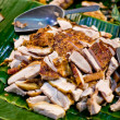 Stock Photo: Crispy fried pork on bananleaf