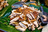 Crispy fried pork on banana leaf — Stock Photo