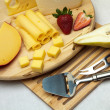 A set of cheese on a wooden board — Stok fotoğraf