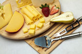 A set of cheese on a wooden board — Stock Photo