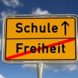 German road sign freedom and school - Stock Photo