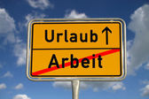 German road sign work and vacation — Stock Photo
