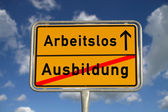 German road sign apprenticeship and unemployed — Stock Photo
