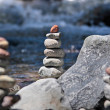 Royalty-Free Stock Photo: Cairn by the stream