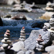 Cairn by the stream — 图库照片