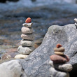 Stock Photo: Cairn by the stream