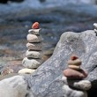 Cairn by the stream - Stock Photo