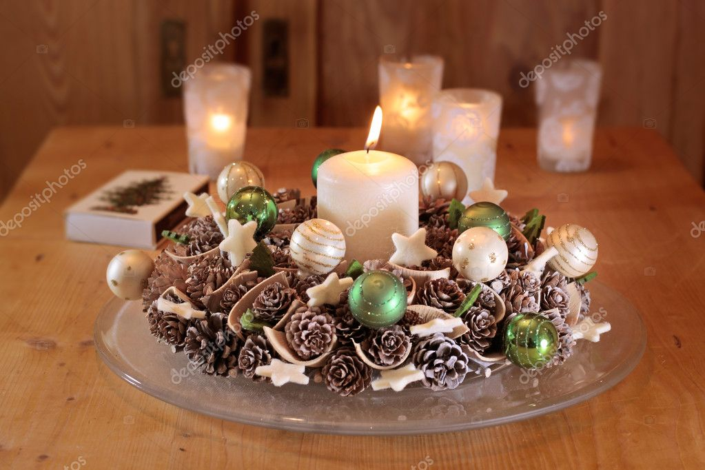 Advent  wreath with pine cones  and  burning candle — Stock Photo #6746380