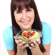 Woman holding a bowl with salad — Stock Photo