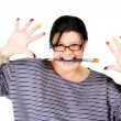 Female artist holding paintbrush in mouth — Stock Photo