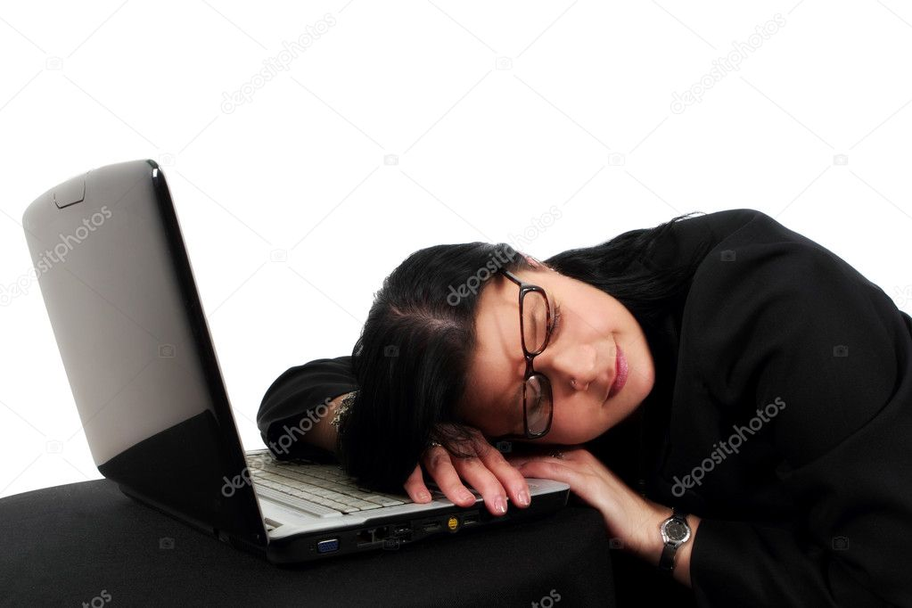 Woman who has fallen asleep on her laptop keyboard — Stock Photo #5597193