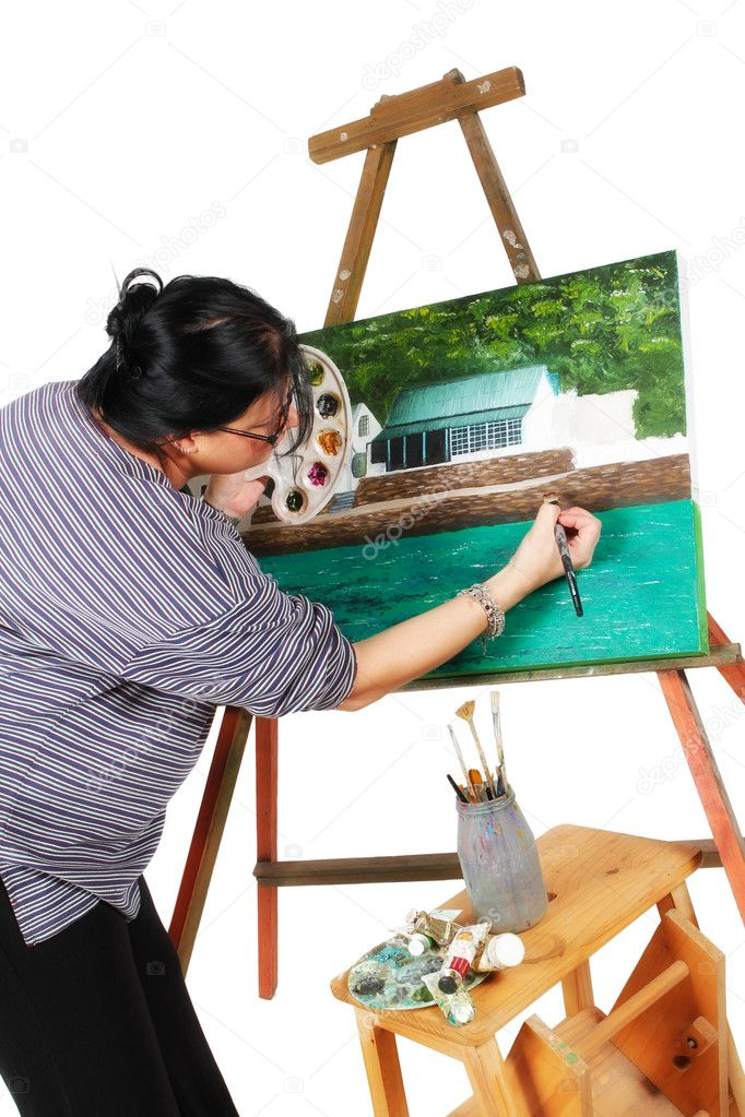 Female artist painting a picture of a house on a white background — Stock Photo #5597413